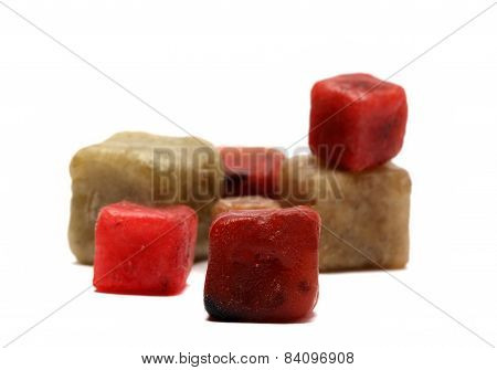 Small Paraffin Cubes On A White Background