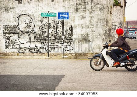 Malaysia, Penang, Georgetown - Circa Jul 2014: A Simple Mural Explains A Cultural And Historical Poi