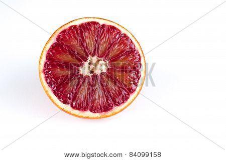 Half Of Red Blood Sicilian Orange Isolated On White