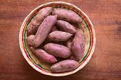 stock photo of batata  - Overhead shot of raw purple sweet potato  - JPG