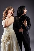 stock photo of lesbian  - Elegant lesbian couple posing as bride and groom - JPG