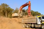 pic of track-hoe  - Track hoe excavator loading a 10 - JPG