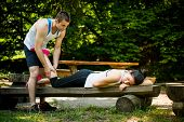 picture of calves  - Man gives massage of calf to his girlfriend after sport training  - JPG