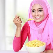 image of muslimah  - portrait of beautiful young woman had a cereal for breakfast - JPG
