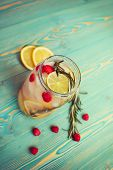 pic of refreshing  - refreshing detox water with fruits in jar on wooden table - JPG
