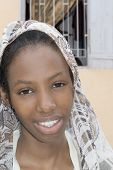 image of plumper  - Young Afro beauty wearing a veil in the street - JPG