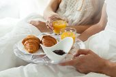 stock photo of morning  - Eating breakfast in bed in lazy morning - JPG