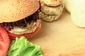 picture of veggie burger  - Vegan sea burger and patties closeup on wooden surface - JPG