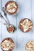 pic of quinoa  - Three bowls of red quinoa with apples yogurt and granola over a wooden blue background shot from above - JPG