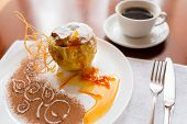 picture of white sugar  - Baked apple with honey beautifully decorated white powdered sugar and a cup of coffee - JPG