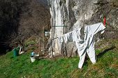 stock photo of scarecrow  - Scarecrow improvised in the mountain during the spring season - JPG