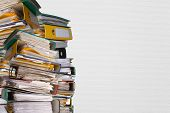 stock photo of piles  - Piles Of File Binder With Documents on white background - JPG