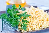picture of grating  - grated cheese on plate and on a table - JPG