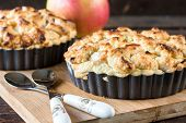 foto of pie-in-face  - Selective focus on the front baked apple pie - JPG