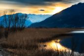 picture of prairie  - Sunset in a river in the mountains on the Prairie - JPG