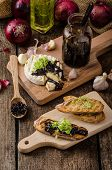 stock photo of brie cheese  - Toasted bread with brie cheese and caramelized onions home made onion  - JPG