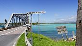 stock photo of inlet  - The bridge over Wagonga Inlet on a sunny day at Narooma with Mt Gulaga in the distance - JPG