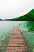 stock photo of dock a lake  - Long Dock and Amazing View of a Beautiful Lake - JPG