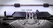 stock photo of typewriter  - Vintage inscription made by old typewriter our rules - JPG