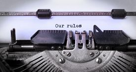 stock photo of old vintage typewriter  - Vintage inscription made by old typewriter our rules - JPG