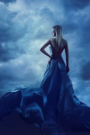 image of hair motion  - Woman Back Portrait in Evening Dress Lady in Silk Gown Cloth Flying over Blue Sky Night Clouds - JPG