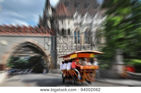 Abstract Background.   Bierbike With Tourists Is Entering The Gate Vajdahunyad Castle -  Radial Zoom