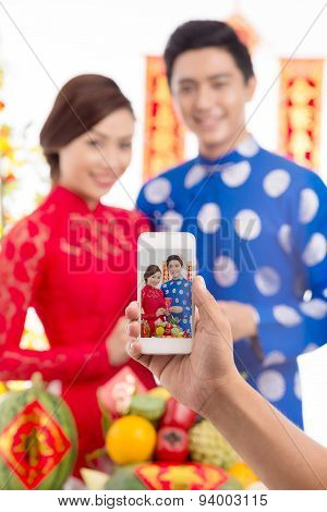 Taking Photo Of Couple