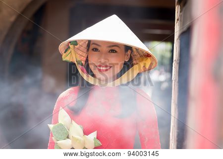 Woman In Conical Hat