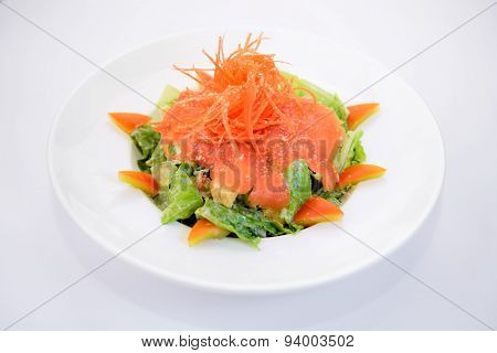 Smoke salmon caesar on white plate