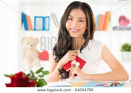 Happy Woman With Valentines Greeting Card