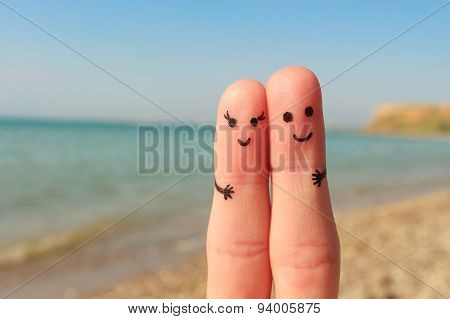 Finger art of a Happy couple. Man and woman have a rest on the beach sea. Man and woman hug on the b