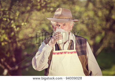 Farmer with milk jug