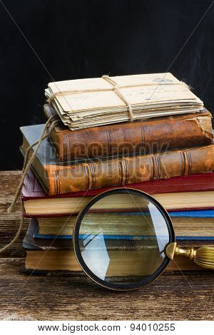 pile of books with looking glass