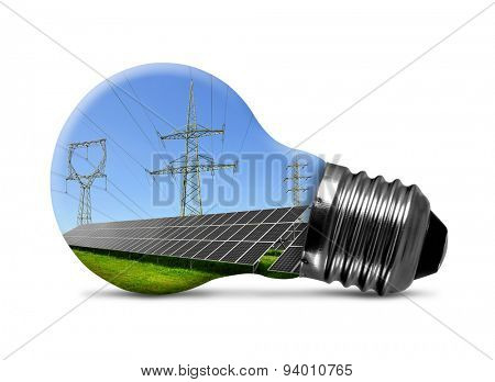 Solar panels with pylons in light bulb isolated on white. Green energy concept.
