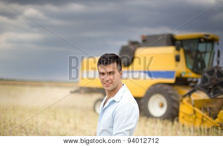 Farmer With Combine In Background