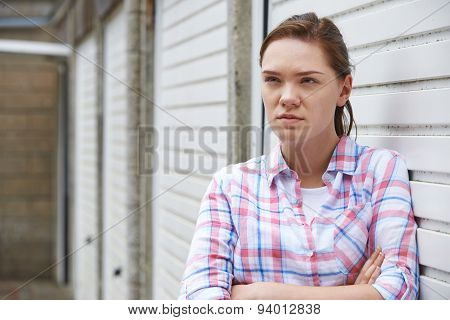 Unhappy Teenage Girl In Urban Setting