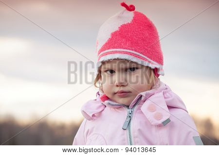 Cute Baby Girl In Pink Hat Angry Frowns