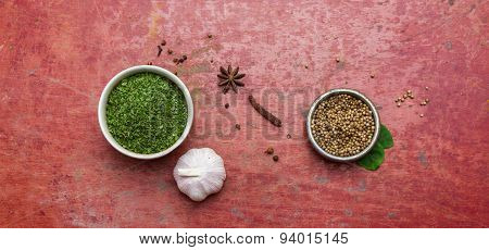 Mixed Spices And Herbs.food And Cuisine Ingredients Red Background.