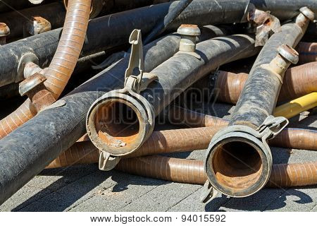 Rubber Tubes With Couplings On A Construction Site