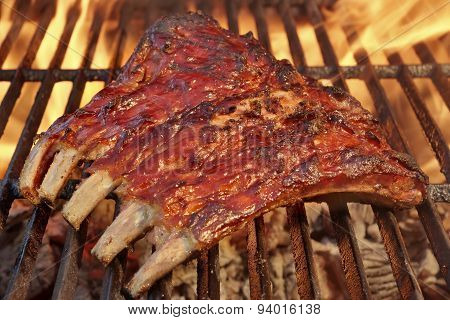 Pork Spare Ribs On The Hot Flaming  Barbecue Grill