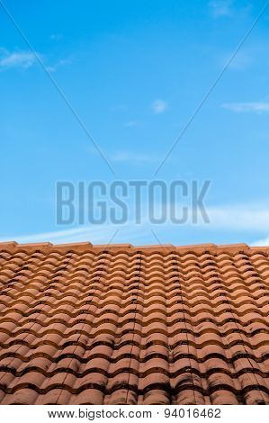 Red Tiles Under Blue Skies