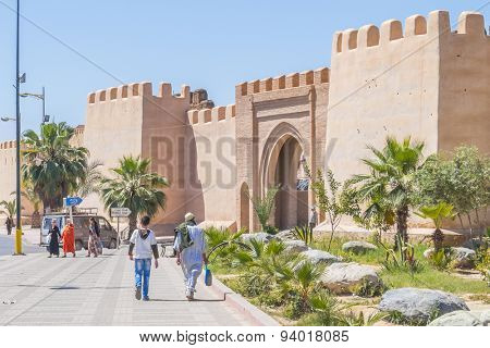 TAROUDANT, MOROCCO, APRIL 9, 2015: Local people walk near Bab Leblaliaa (gate in ancient walls)