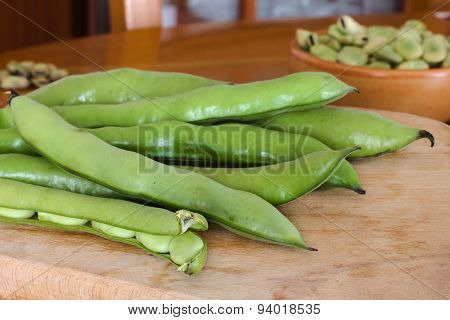 Fresh broad beans fava on wood table