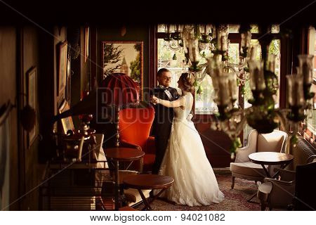 Bride And Groom Dancing In A Beautiful Room