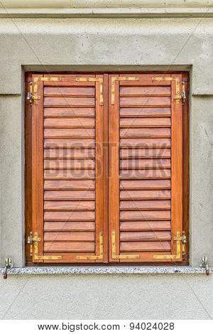 Brown Window Withclosed Shutters