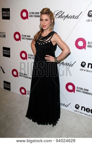 LOS ANGELES - MAR 3:  Tara Lipinski at the Elton John AIDS Foundation's Oscar Viewing Party at the West Hollywood Park on March 3, 2014 in West Hollywood, CA