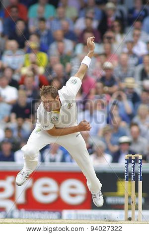MANCHESTER, ENGLAND - August 04 2013: Ryan Harris bowling during day four of  the Investec Ashes 4th test match at Old Trafford Cricket Ground, on August 04, 2013 in London, England.