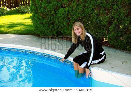 Pretty Teen Girl At Pool