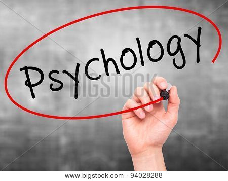 Man Hand writing Psychology with black marker on visual screen.