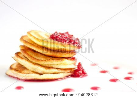 Pancakes On The White Plate With Raspberry Jam